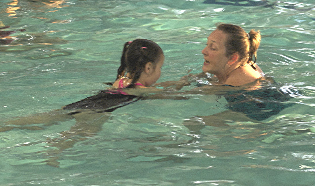 Linda Teaching Child to Swim